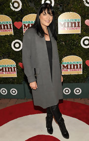 Selma Blair layered a thick gray duster over her monochromatic red carpet style at the launch of Harajuku Mini.