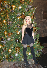 Gwen Stefani vamped it up in an Elie Saab LBD with a lace-panel, heart-motif bodice while promoting the Holiday Light Show at the Empire State Building.