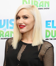 Gwen Stefani's red lippy looked vibrant against her alabaster skin.