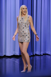 Gwen Stefani flashed an eyeful of leg in a super-short silver dress by Kaufmanfranco while visiting 'Jimmy Fallon.'