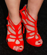 Sally Pressman chose vibrant red sandals to add some color to her navy and khaki red carpet look.