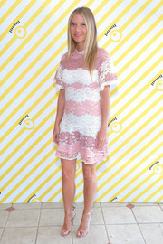 Gwyneth Paltrow complemented her dress with a pair of dusty-pink satin sandals by Gianvito Rossi.