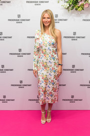 Gwyneth Paltrow paired her cute dress with silver ankle-strap sandals by Jimmy Choo.