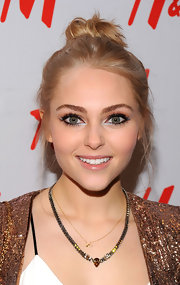 Annasophia Robb opted for a more casual look with this messy-but-cool twisted bun.