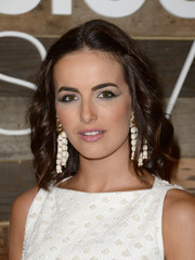 Camilla Belle modernized her cat eyes with a swipe of metallic silver shadow.