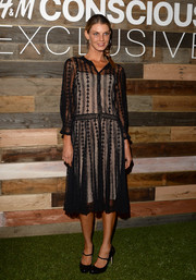 Angela Lindvall amped up the retro vibe with a pair of black Mary Janes.