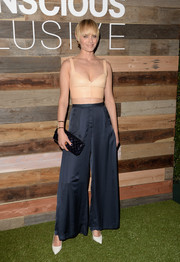 Amber Valletta opted for a pair of blue wide-leg pants from the H&M Conscious Collection to team with her sexy top.