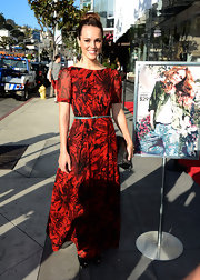Erin Cahill looked bright and summery in this bold red floral maxi with a skinny turquoise belt.