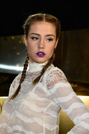 Adele Exarchopoulos channeled her inner little girl with this double French braid at the H&M fashion show.