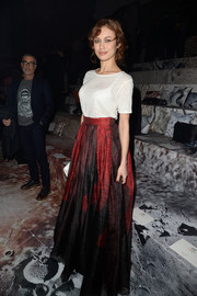 Olga Kurylenko attended the H&M fashion show wearing a white tee from the brand's Conscious Exclusive collection.
