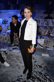 Deborah Francois attended the H&M fashion show wearing a white cropped jacket with black pants.