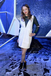 Christa Theret kept it casual and youthful at the H&M fashion show in a white jumper dress layered over a sweater.
