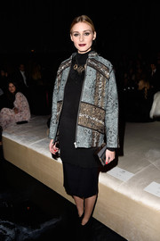 Olivia Palermo covered up in a printed zip-up jacket by H&M for the brand's fashion show.
