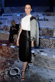 Erin O'Connor finished off her outfit with a gray satin bomber jacket draped languidly over her shoulders.