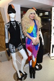 Lady Gaga cut a colorful figure in a brushstroke-print jumpsuit at the H&M store opening in Times Square.