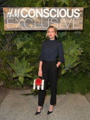 Erin Foster was classic and cute in a navy polka-dot blouse with bell sleeves at the H&M Conscious Exclusive dinner.