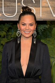 Chrissy Teigen slicked her hair back into a braided top bun for the H&M Conscious Exclusive dinner.