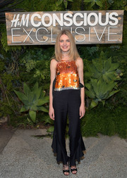 Natalia Vodianova caught eyes in a sparky orange paillette-embellished top at the H&M Conscious Exclusive dinner.