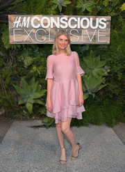 Angela Lindvall went the ultra-sweet route in a pink cocktail dress with a tiered skirt and bell sleeves at the H&M Conscious Exclusive dinner.