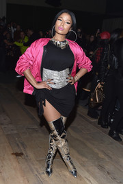 Nicki Minaj wrapped up her curves in a little black dress with an asymmetrical hem for the H&M fashion show.