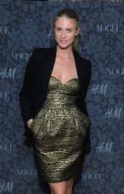 Julie Henderson looked ultra chic in a textured gold cocktail dress, worn with a black blazer, at the H&M and Vogue Studios Between the Shows party.