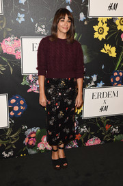 Rashida Jones embraced fall in a fuzzy burgundy crewneck sweater at the Erdem x H&M runway show.