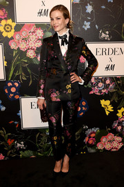 Sylvia Hoeks showed us how to suit up the girly way at the Erdem x H&M runway show.