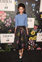 Zendaya Coleman looked effortlessly chic in a periwinkle cable-knit sweater at the Erdem x H&M runway show.