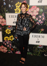 Ahna O'Reilly looked demure in a loose floral blouse with a lace yoke and sleeves at the Erdem x H&M runway show.