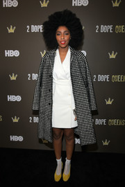 Jessica Williams layered a black-and-white gingham coat over a wrap dress for the '2 Dope Queens' slumber party premiere.