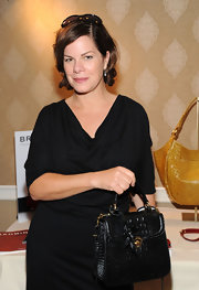 Marcia Gay Harden carried a croc-embossed satchel at the HBO Luxury Lounge.