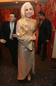 Lady Gaga was all about boudoir glamour at HBO's Golden Globes after-party in a one-sleeve gown by Perry Meek that looked like a half-undone robe, revealing a beaded bustier underneath.