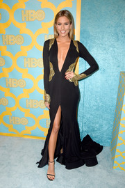 Renee Bargh looked va-va-voom at the HBO Golden Globes party in an MT Costello gold-lace-accented black gown with a down-to-the-navel neckline and a high front slit.