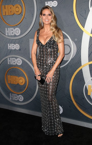 Heidi Klum finished off her outfit with a black box clutch by Judith Leiber.