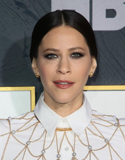 Jackie Tohn attended the HBO post-Emmy reception wearing her hair in a center-parted chignon.