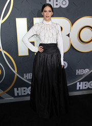 Jackie Tohn donned a basic white button-down, which she glammed up with a statement necklace, for the HBO post-Emmy reception.