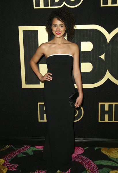 Nathalie Emmanuel complemented her gown with a black velvet clutch.