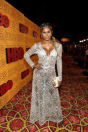 Laverne Cox completed her look with a cream and gold hard-case clutch.