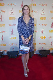 Kim Dickens showed up in a print wrap dress to the New Orleans Fundraiser. She carried a satin silver evening bag while walking the red carpet.