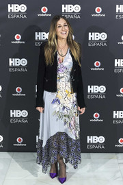 Sarah Jessica Parker added an extra pop of color with a pair of purple satin pumps from her label.