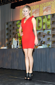 Anna Paquin toughened her flirty red pencil dress at Comic-Con with a pair of black leather cutout booties.