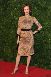 Karen Elson wore a demure print cocktail dress with delicate sleeve trim for the 'Vogue' soiree.