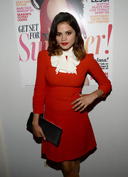 Melonie Diaz went for a bit of a retro feel with this structured red and white tie-neck dress at the Elizabeth and James collection party.
