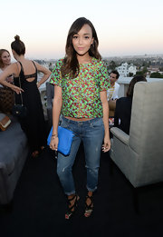 Ashley Madekwe played with contrasts with this feminine floral blouse and ripped jeans combo at the Elizabeth and James collection party.