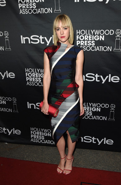 Jena Malone matched her footwear with a red satin tube clutch by Jimmy Choo.