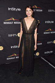 Margaret Qualley sported a black Philosophy di Lorenzo Serafini lace gown with a deep-V neckline at the HFPA and InStyle TIFF celebration.