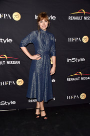 Imogen Poots shimmered in a metallic blue cocktail dress at the HFPA and InStyle TIFF celebration.