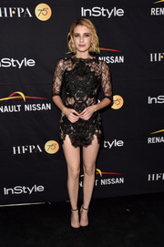 Emma Roberts unleashed her sultry side with this sheer black lace mini dress with strategically placed appliques during the HFPA and InStyle TIFF celebration.