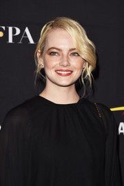 Emma Stone looked effortlessly elegant with her loose updo at the HFPA and InStyle TIFF celebration.