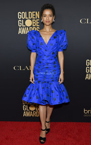 Gugu Mbatha-Raw looked downright darling in a heart-adorned electric-blue dress with puffed sleeves and a flared hem at the HFPA Golden Globe ambassador party.